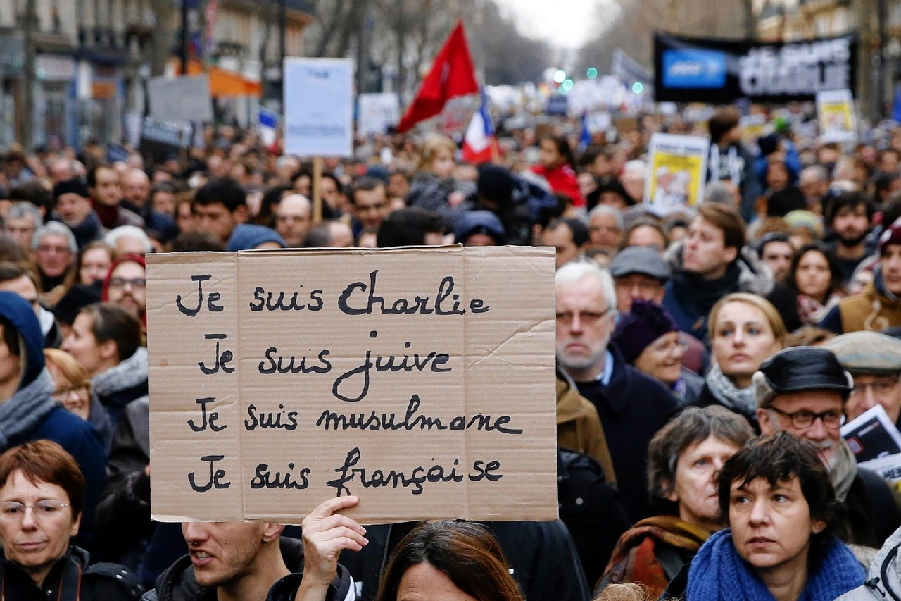 A Woman Holds Up Sign That Says I Am Charlie Jewish Muslim French During Rally In Paris On Jan 11 Agence France Presse Getty