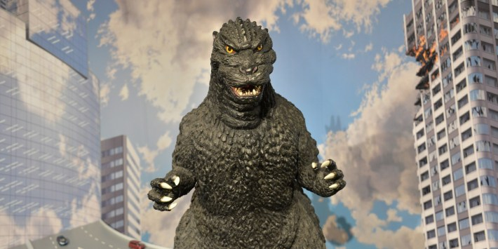A 1-metre tall statue of Godzilla is displayed at a Godzilla art exhibition in Tokyo on May 2, 2014. Japanese fans of Godzilla say the newly-unveiled monster, set to star in a Hollywood reboot of the post-war classic, is too fat and has been